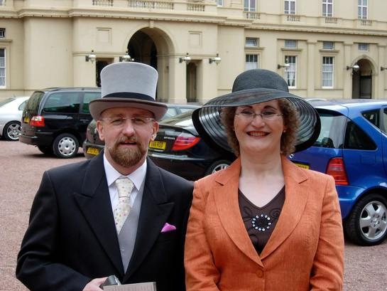 Christine Burns MBE and Stephen Whittle OBE at Buckingham Palace